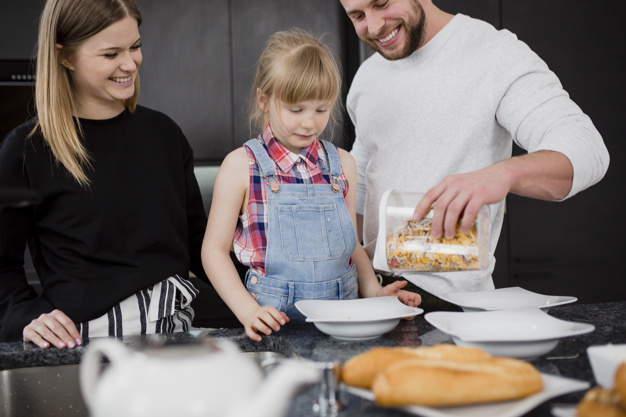 parents and daughter cooking breakfast 23 2147800386