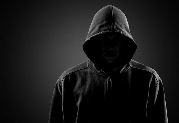 depositphotos 118566652 stock photo dark unrecognisable man in hoodie