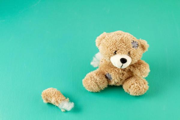 depositphotos 286972796 stock photo toy teddy bear with teared